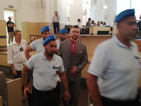 Маркива (на фото в центре) приговорили к 24 годам тюрьмы