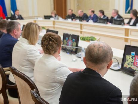 Депутат с татуировкой паука Евгений Сурнин