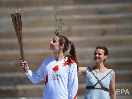 В Греции без зрителей прошла церемония передачи олимпийского огня Японии