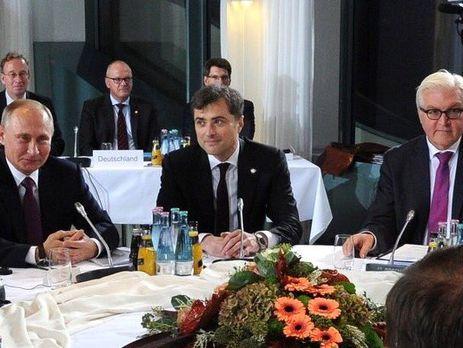 Сурков между Путиным и министром иностранных дел Германии Штайнмайером