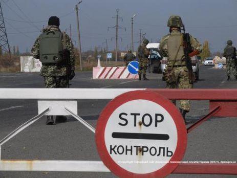 Боевики обстреляли пункт пропуска «Майорск»: сгорели два автомобиля,— штаб АТО