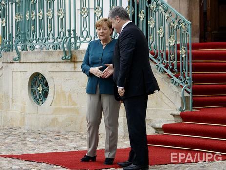 П.Порошенко начал встречу с А.Меркель